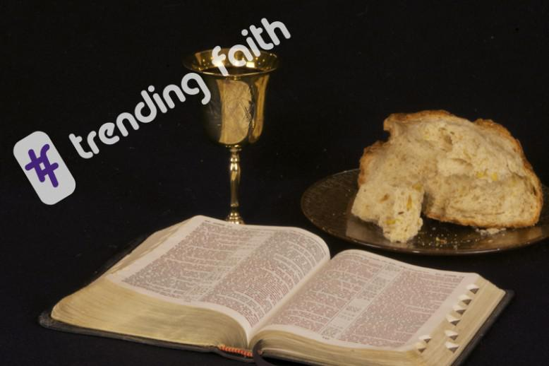 A Bible with bread and wine under the Trending Faith logo