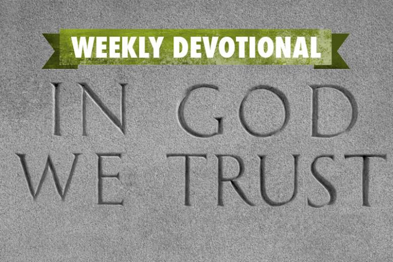 """The Weekly Devotional banner above an """"In God We Trust"""" engraving"""