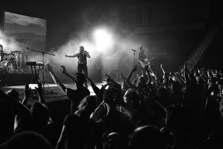 people worshiping in black and white