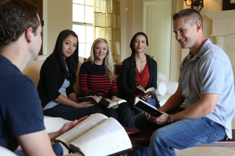 A group of students studying the Bible