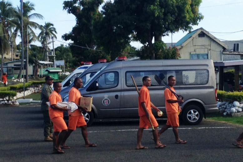 people wearing orange carrying different items