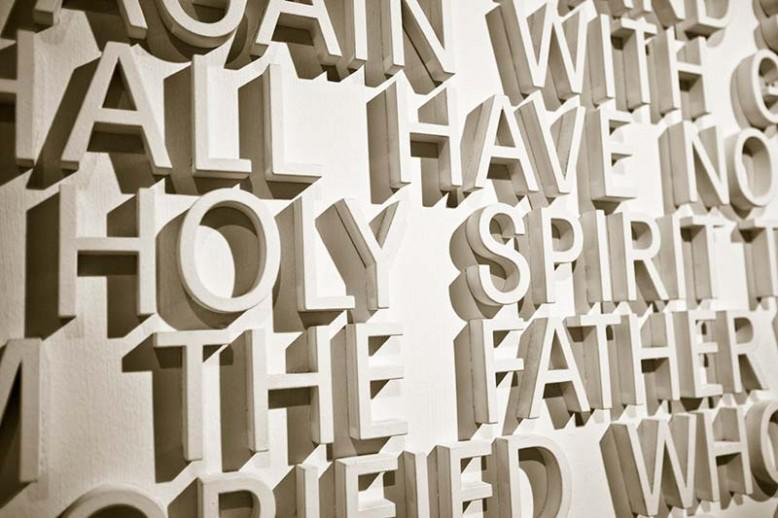 """""""holy spirit"""" written with white letters on a wall"""