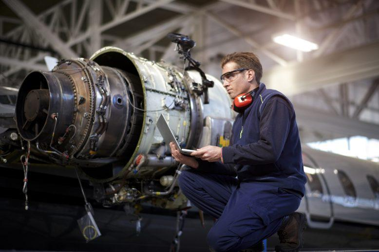 Man working on airplane