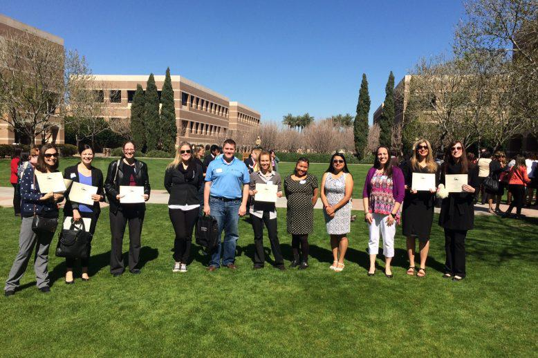 people holding certificates and smiling