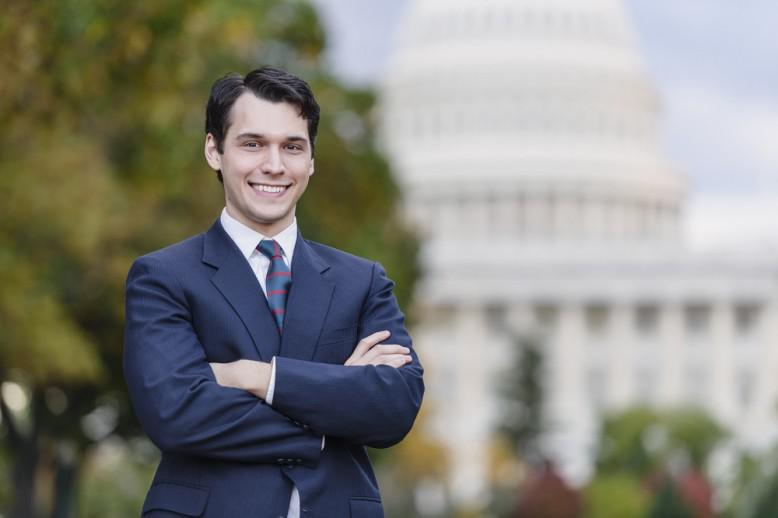 Man standing in front of a government building in D.C.