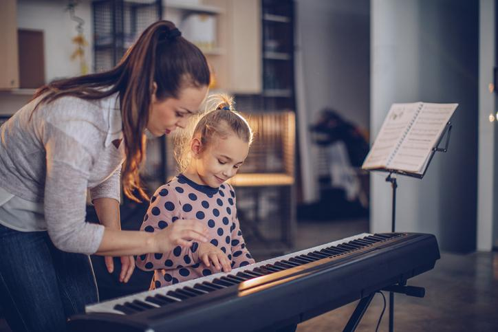 Piano teacher working with a student