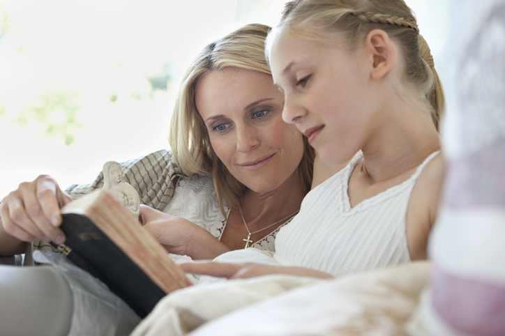 mom and girl reading Bible