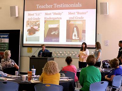 Teachers presenting slideshow