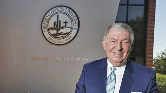 Jerry Colangelo in front of the CCOB building at naming ceremony