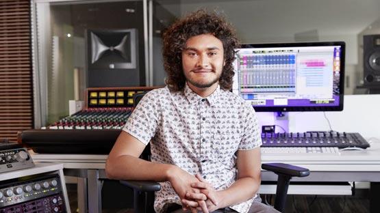 student in GCU Recording Studio