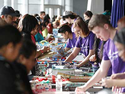 GCU Lopes help wrap toys and gifts from the annual Christmas toy drive.