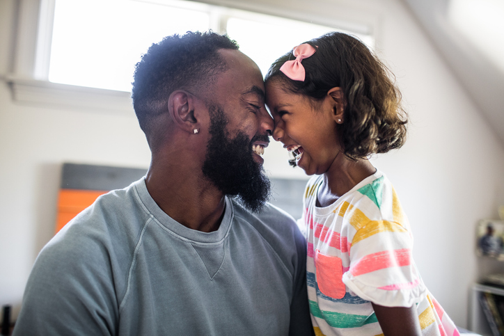 man and child smiling